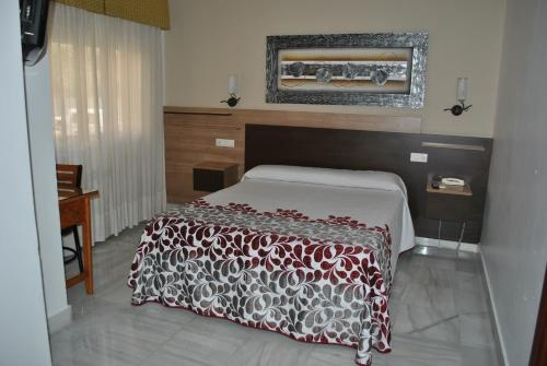 Cama o camas de una habitación en Hotel Albero