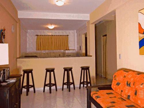 A seating area at Aparthotel Eporedia