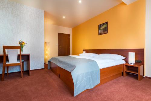 Postel nebo postele na pokoji v ubytování Hotel SKANZEN