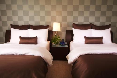 Säng eller sängar i ett rum på Provident Doral At The Blue