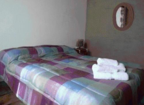 A bed or beds in a room at Cabañas Luna y Sol