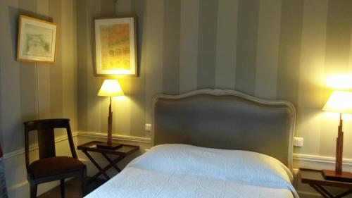 A bed or beds in a room at Maison Epellius