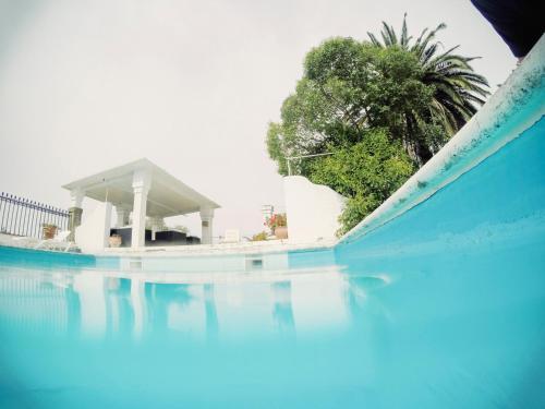 The swimming pool at or near Hotel Rural Histórico El Vaqueril
