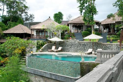 The swimming pool at or near Ubud Dedari Villas