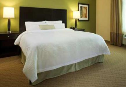 A bed or beds in a room at Hampton Inn Orange City