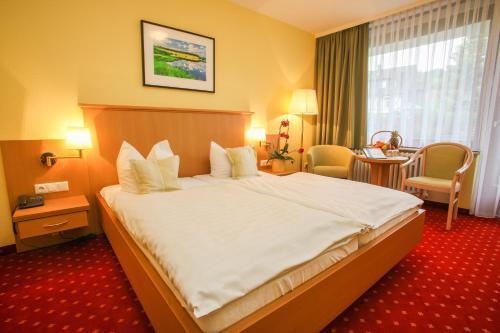 Ein Bett oder Betten in einem Zimmer der Unterkunft Hotel Riemann