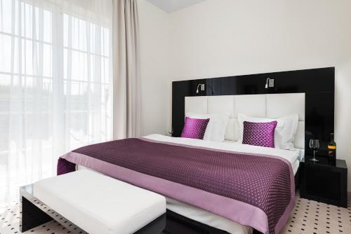 Кровать или кровати в номере Apartamenty M&M