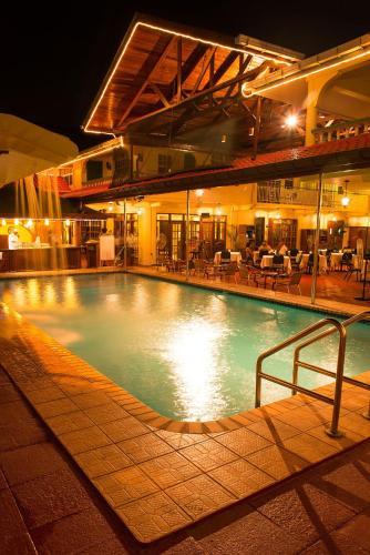 The swimming pool at or near Grand Coastal Hotel