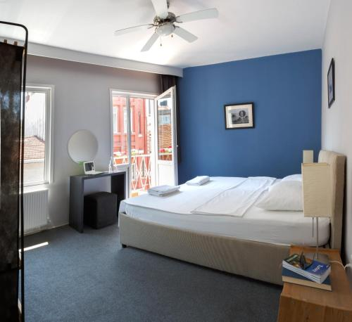 A bed or beds in a room at Hush Hostel Lounge