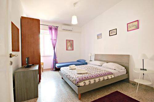 Cama o camas de una habitación en Scalini di Trastevere