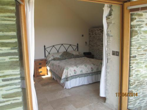 A bed or beds in a room at White Willow
