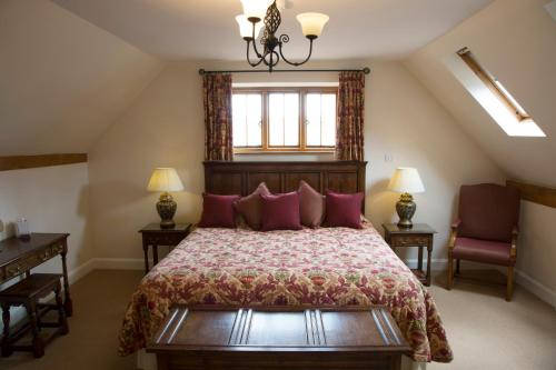 A bed or beds in a room at The Town House Ludlow