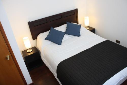 Cama o camas de una habitación en Hostal Buró
