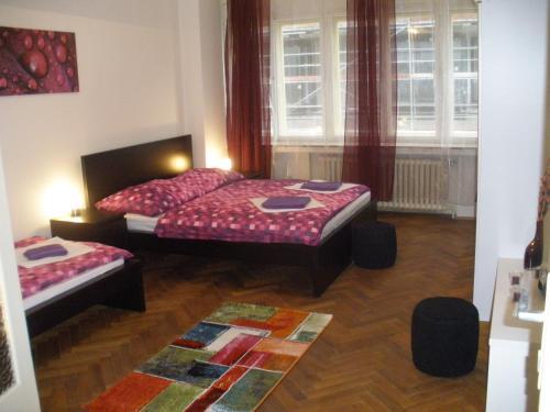 Łóżko lub łóżka w pokoju w obiekcie Apartments Tronicek