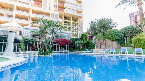 The swimming pool at or near Aparthotel El Faro