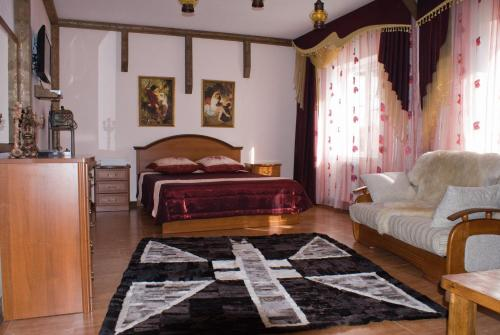 A bed or beds in a room at Kavkazskie Legendy