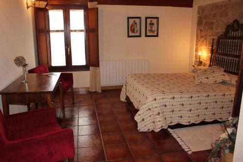 Cama o camas de una habitación en Casa Rural El Meson
