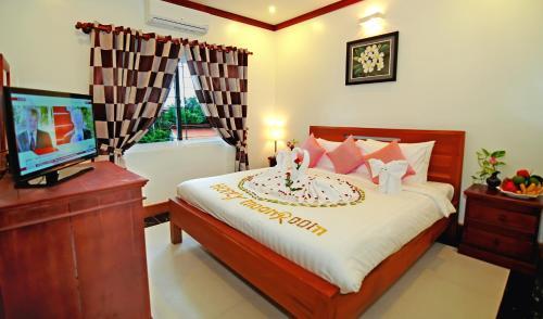 Cama ou camas em um quarto em Visoth Boutique