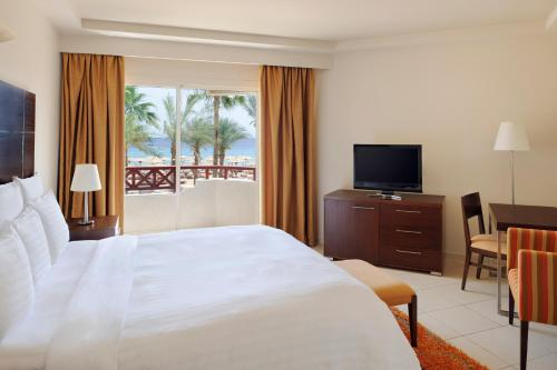 A television and/or entertainment center at Naama Bay Promenade Resort Managed By Accor