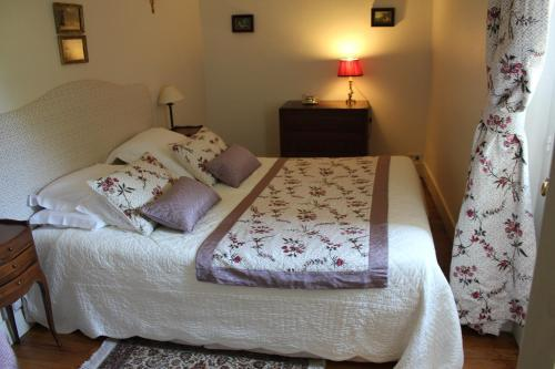 Un ou plusieurs lits dans un hébergement de l'établissement Appartement du Château du Grand Bouchet