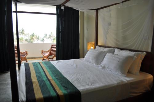 Esprit d'Ici Hotelにあるベッド