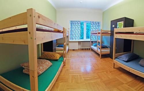 A bunk bed or bunk beds in a room at The Monk's Bunk Kaunas