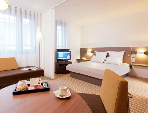 A bed or beds in a room at Novotel Suites Lille Europe