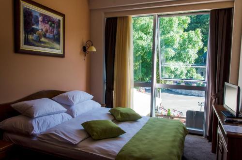 Krevet ili kreveti u jedinici u okviru objekta Hotel Monte Rosa