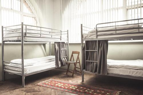 A bunk bed or bunk beds in a room at Hatters Manchester