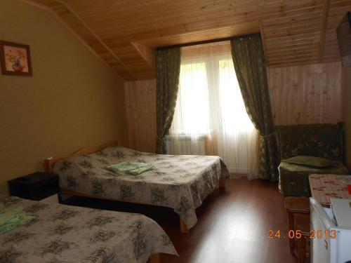 Кровать или кровати в номере Гостевой Дом Ирина
