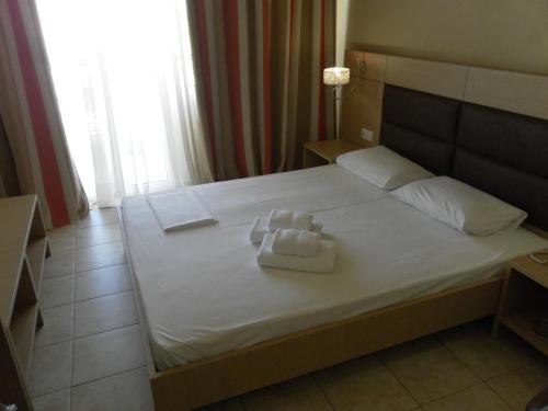 Łóżko lub łóżka w pokoju w obiekcie Esperia