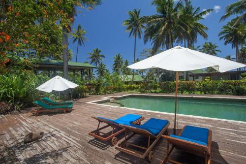 The swimming pool at or near Maravu Taveuni Lodge