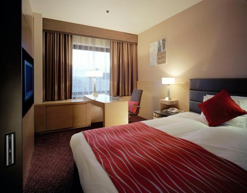 Tempat tidur dalam kamar di Toyama Daiichi Hotel