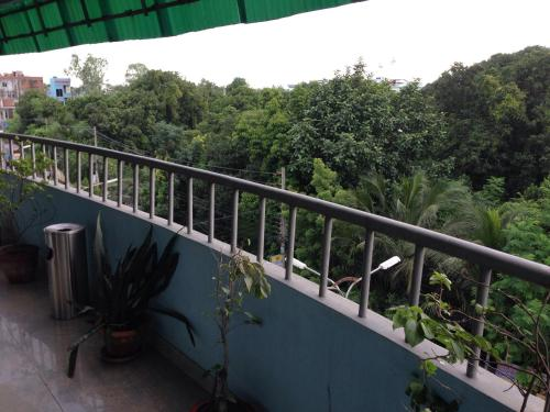 A balcony or terrace at Red Chillies Restaurant and Guest house