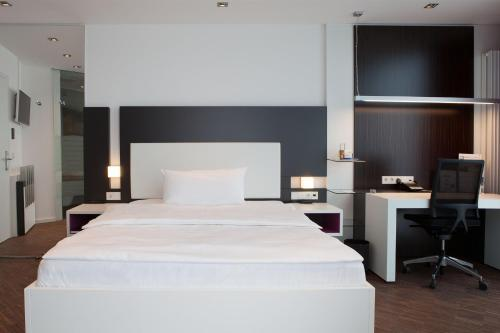 A bed or beds in a room at Hotel Schloss Montabaur