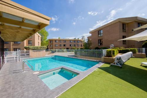 The swimming pool at or near Accommodate Canberra - Kingston Court