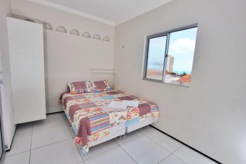 A bed or beds in a room at Residencial Santa Lucia