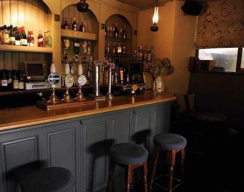 The lounge or bar area at Falcon Inn