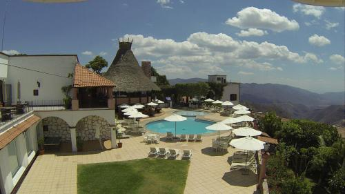 A view of the pool at Hotel Montetaxco or nearby