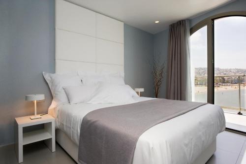 Cama o camas de una habitación en Hotel Boutique La Mar - Adults Only