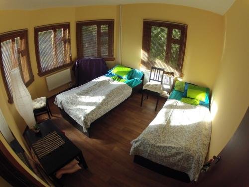A bed or beds in a room at Serpeyka Guesthouse