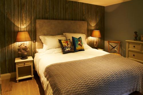 A bed or beds in a room at Crown and Garter