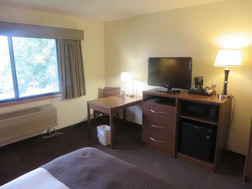 A television and/or entertainment center at AmericInn by Wyndham Worthington