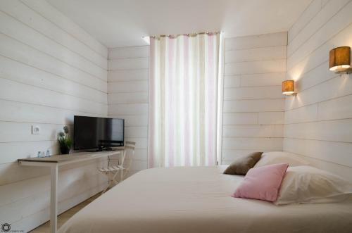 Un ou plusieurs lits dans un hébergement de l'établissement Hotel de la Gare