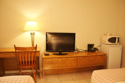 A television and/or entertainment center at Tulip Motel