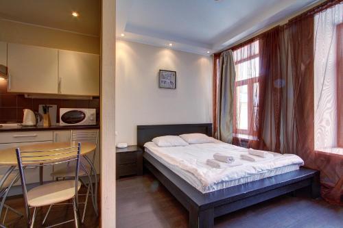 Кровать или кровати в номере СТН Апартаменты на Невском 60
