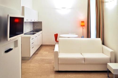 Area soggiorno di BB Hotels Aparthotel Bocconi