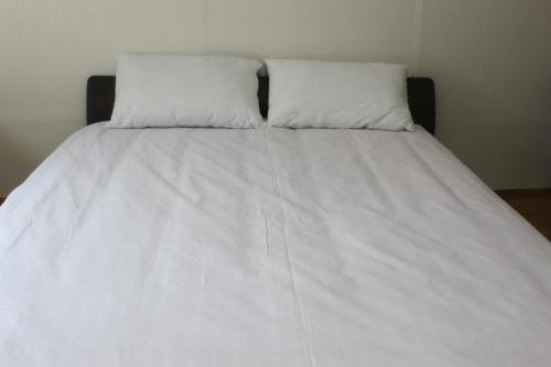 A bed or beds in a room at Dongdaemun Guesthouse