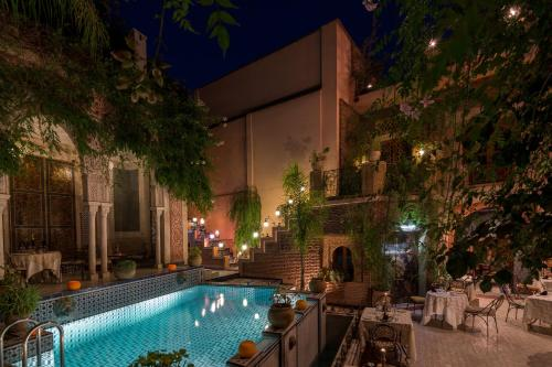 The swimming pool at or near Riad Palais Sebban