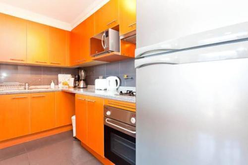 A cozinha ou cozinha compacta de Departamentos Amoblados Costa 151